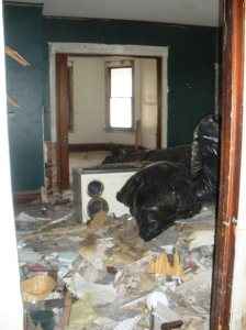 Carpet and debris was thrown in piles around the house
