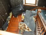 Main stairway to the first floor, blocked by debris